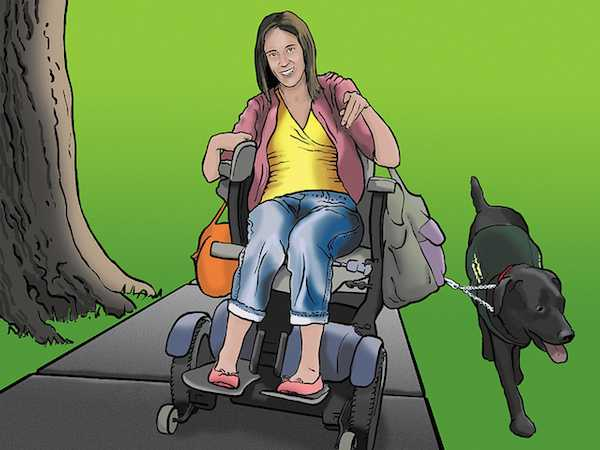 Egy tolószékben ülő hölgy, mellette egy vakvezető kutya